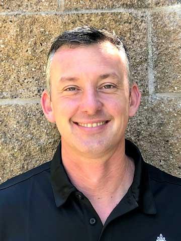 John, staff member at Arbol Residences senior living community