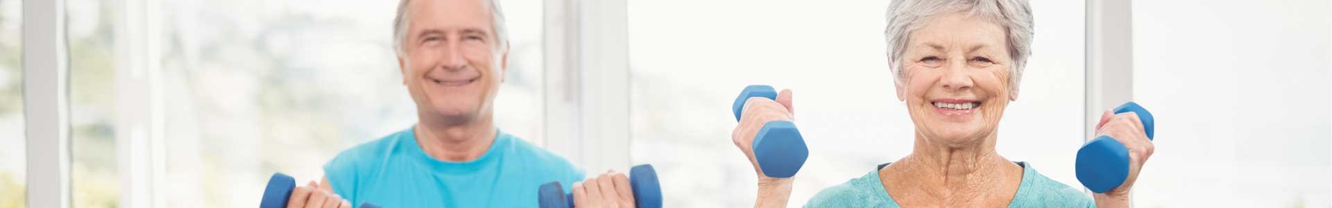 two seniors exercising with weights