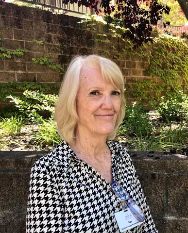 Kay, staff member at Arbol Residences senior living community