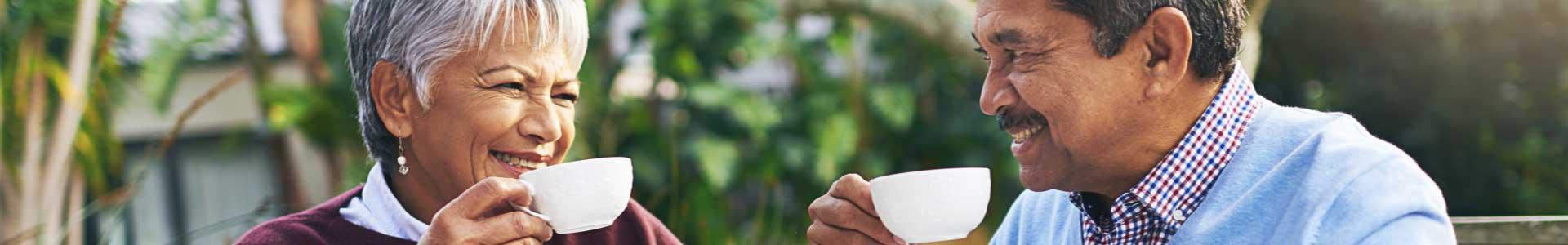 senior couple enjoying tea together outside