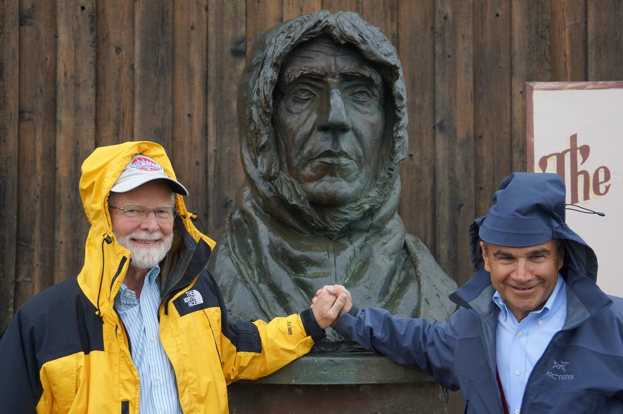 USARC Commissioners Jim McCarthy (left) and Warren Zapol, and a bust of Roald Amundsen, outside City Hall,          Nome, Alaska at USARC's 104th meeting in August 2015.