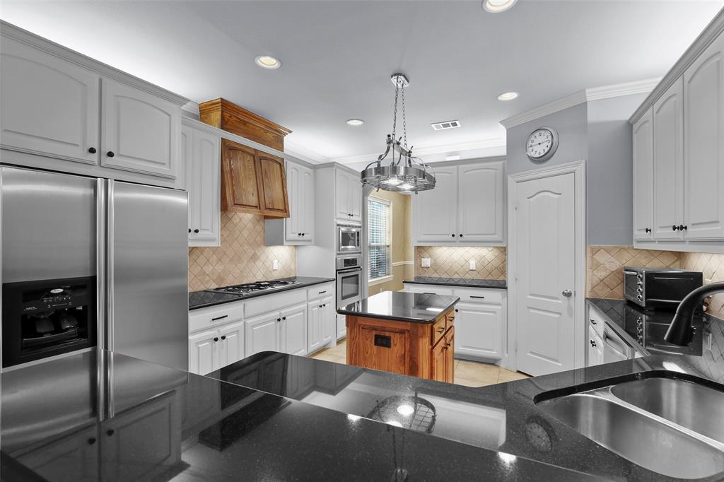 827 Canterbury Drive, Rockwall, Texas 75032 - acquisto real estate best celina realtor logan lawrence best dressed realtor