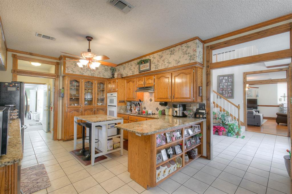 100 Mariah  Drive, Weatherford, Texas 76087 - acquisto real estate best new home sales realtor linda miller executor real estate
