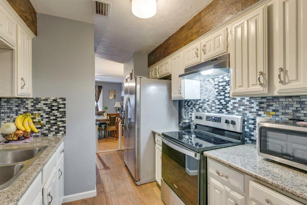 4434 Wind River Lane, Garland, Texas 75042 - acquisto real estate best highland park realtor amy gasperini fast real estate service
