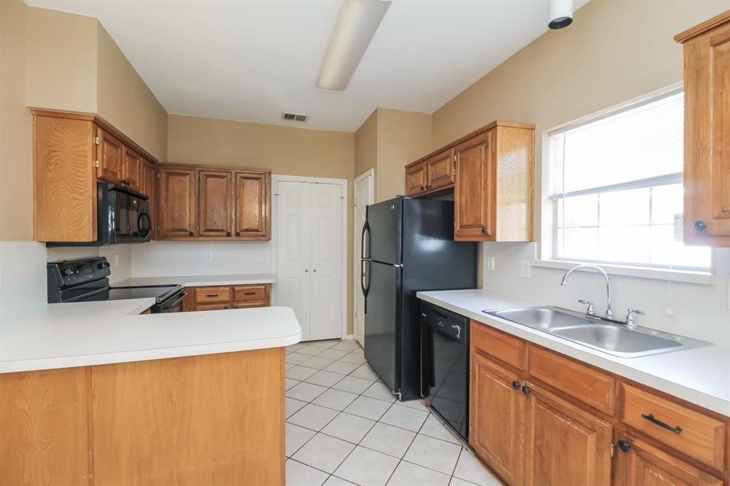 1453 Ridgecreek  Drive, Lewisville, Texas 75067 - acquisto real estate best celina realtor logan lawrence best dressed realtor