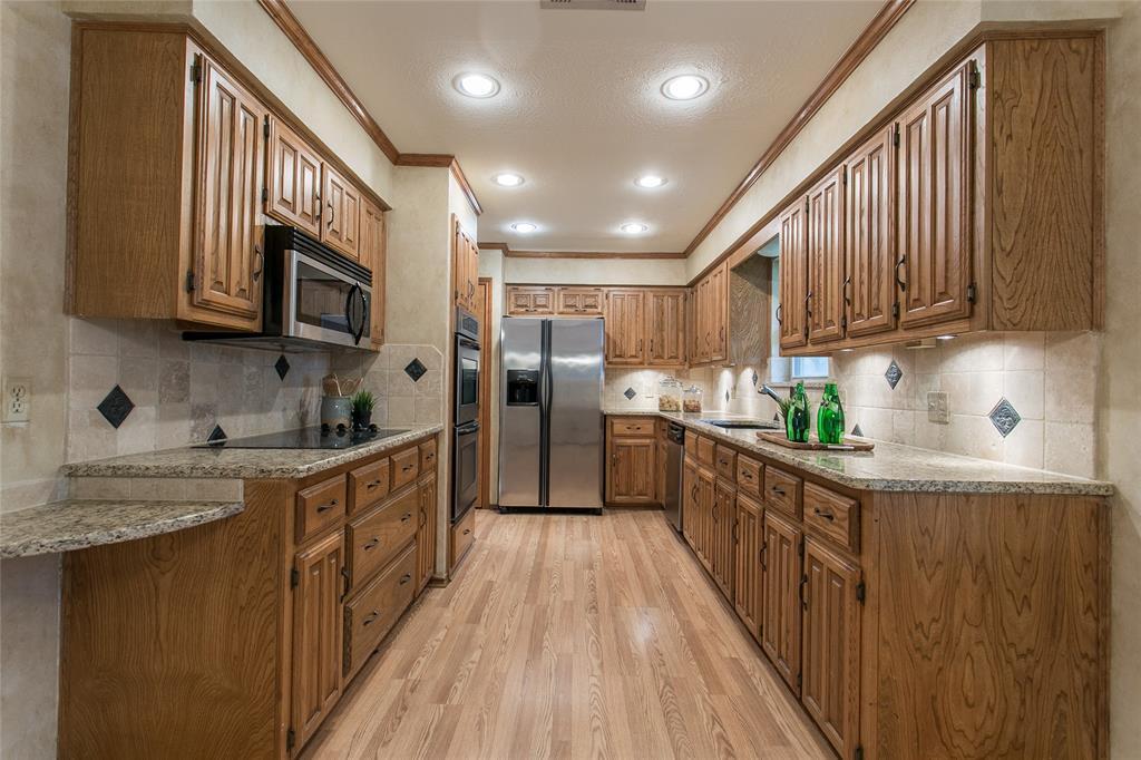 8046 Moss Meadows  Drive, Dallas, Texas 75231 - acquisto real estate best celina realtor logan lawrence best dressed realtor