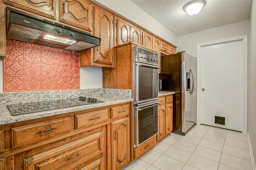 409 Brookfield  Drive, Garland, Texas 75040 - acquisto real estate best celina realtor logan lawrence best dressed realtor