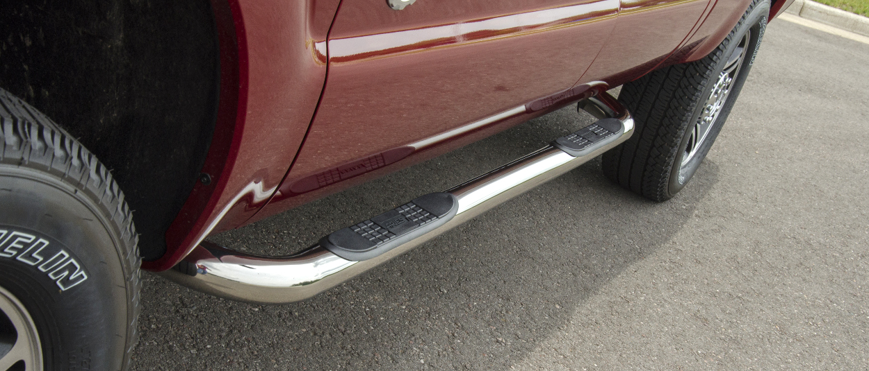 ARIES 3-inch round side bars on red Ford F350 truck