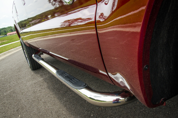 ARIES 3-inch stainless steel side bars on red truck