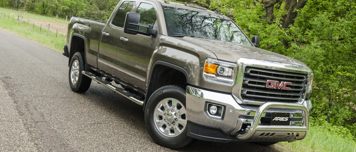 2015 GMC Sierra 2500 HD with ARIES 4-inch oval side bars and accessories