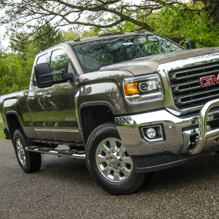 2015 GMC Sierra 2500 HD with ARIES 4-inch oval stainless steel side bars and bull bar