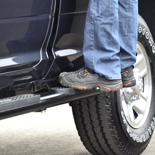 ARIES 4-inch oval side bars wheel-to-wheel steps on blue truck