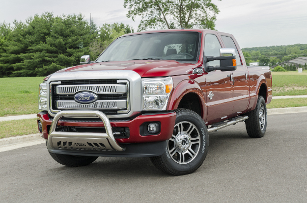 Red Ford F350 with ARIES 4-inch oval side bars and bull bar