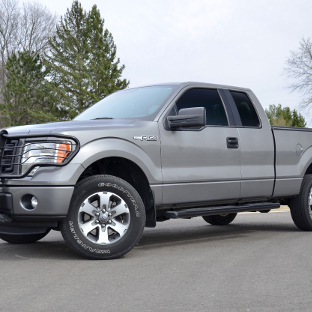 2013 Ford F150 with ARIES 6-inch oval side bars and truck accessories