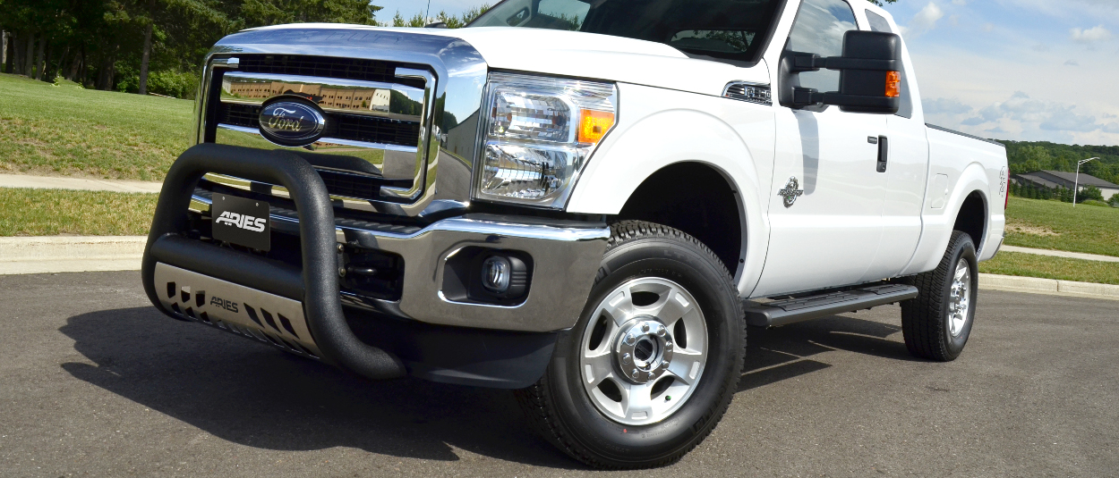 2016 Ford F350 Super Duty with ARIES 6-inch oval side bars and truck accessories
