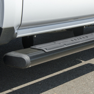 ARIES 6-inch oval black aluminum side bars on white truck