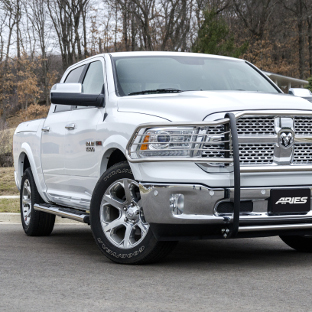 White 2015 Ram 1500 with ARIES 6-inch oval truck steps and truck accessories