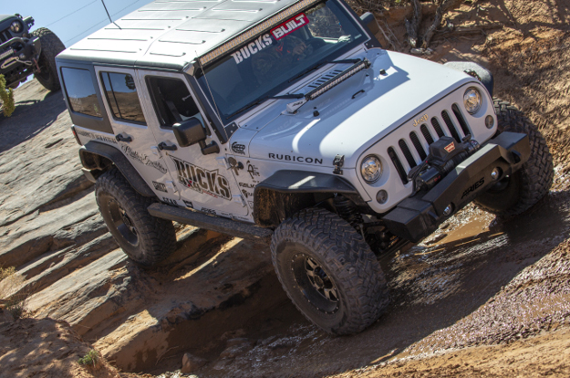 ARIES ActionTrac™ powered running boards on an offroad Jeep Wrangler JK