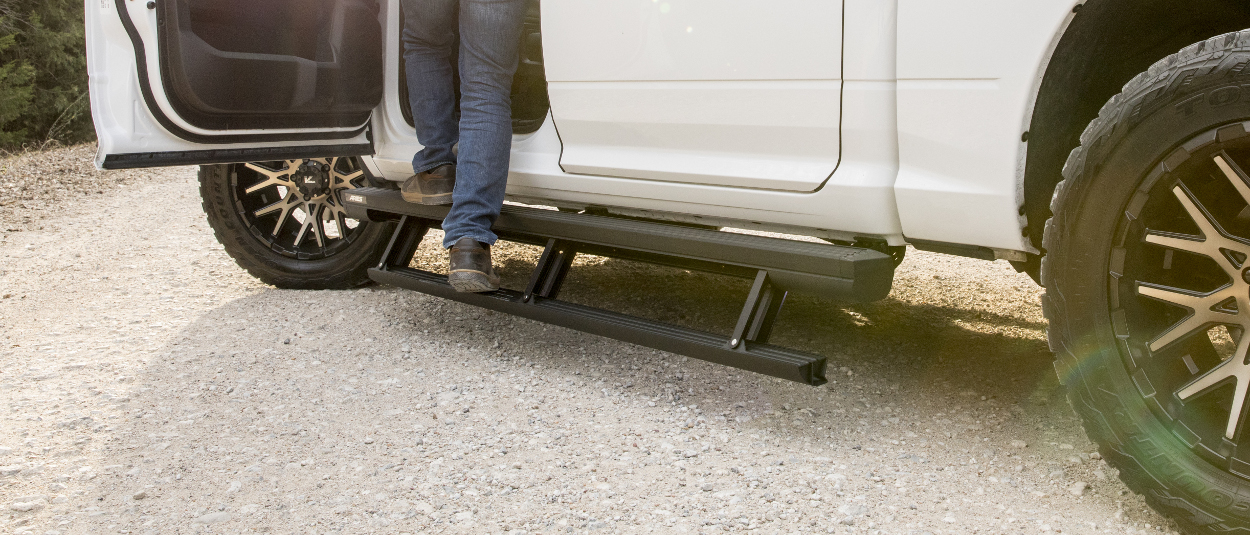 ARIES ActionTrac™ powered running boards on a white truck
