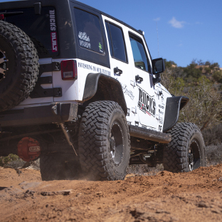 ARIES ActionTrac™ running boards on an offroad Jeep Wrangler JK