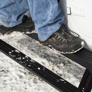 ActionTrac™ running boards two-step access on a Jeep Wrangler JK in the snow
