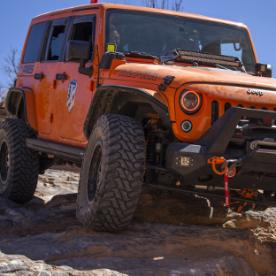 Offroad Jeep Wrangler JK Unlimited with ActionTrac™ power running boards