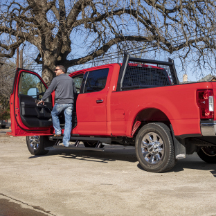 Red Ford F250 Super Duty with ARIES ActionTrac™ powered running boards