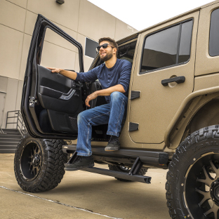 Tan Jeep Wrangler JK with ActionTrac™ power running boards