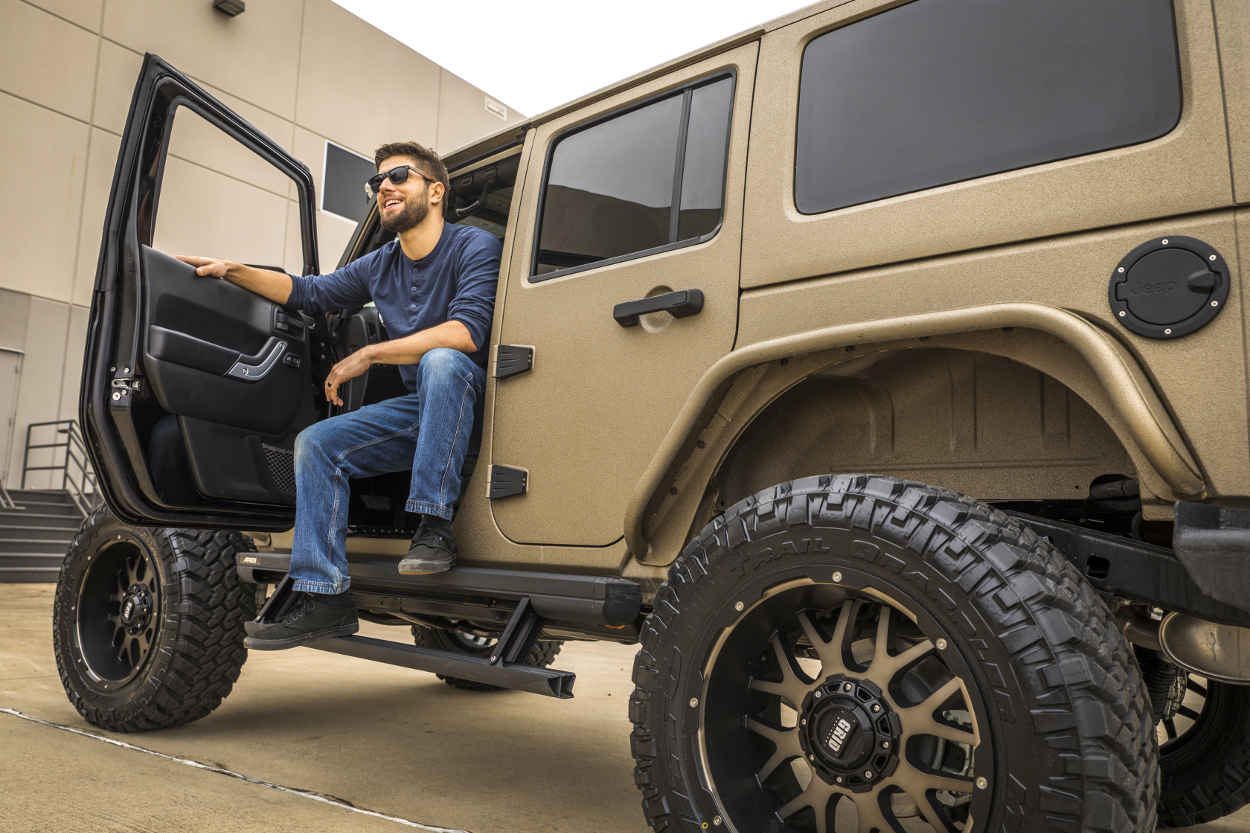 Tan Jeep Wrangler Jk With Actiontrac Running Boards