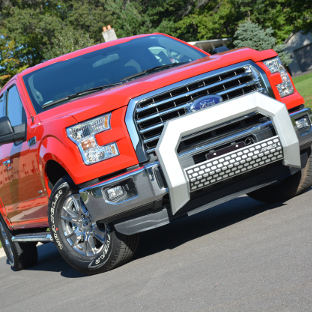 Red 2015 Ford F150 with ARIES AdvantEDGE chrome bull bar