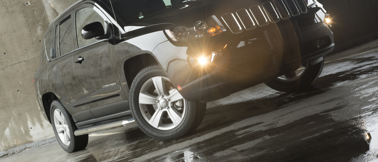2015 Jeep Compass with ARIES AeroTread® SUV running boards