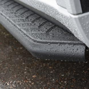 ARIES black AeroTread SUV running boards - rainwater
