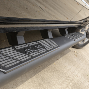 ARIES AscentStep running boards on black GMC Sierra 1500