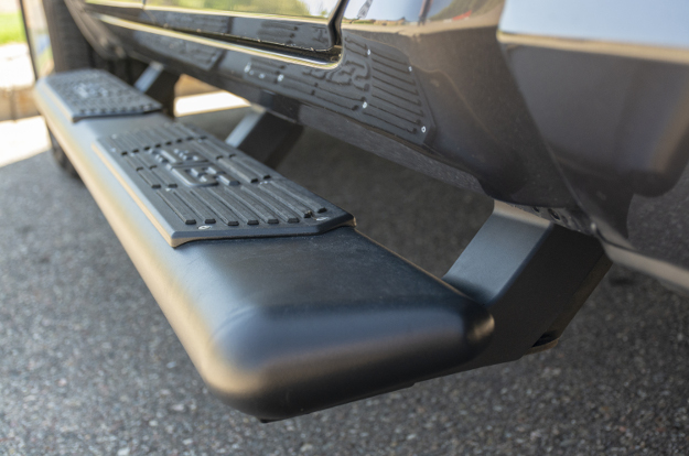 ARIES AscentStep™ truck running boards with VersaTrac® bracket covers