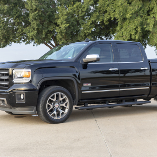 Black 2015 GMC Sierra 1500 with ARIES AscentStep black running boards