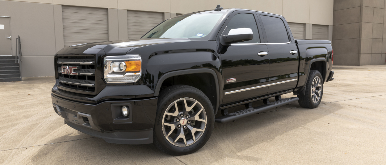 Black 2015 GMC Sierra 1500 with ARIES AscentStep™ running boards