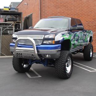Custom lifted Chevrolet Silverado 1500 with ARIES Big Horn bull bar