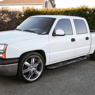 Custom 2007 Chevrolet Silverado 1500 with ARIES Big Step side bars
