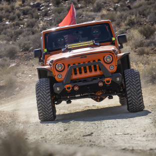 Custom desert 2013 Jeep Wrangler JK with ARIES Jeep fender flares and Jeep accessories