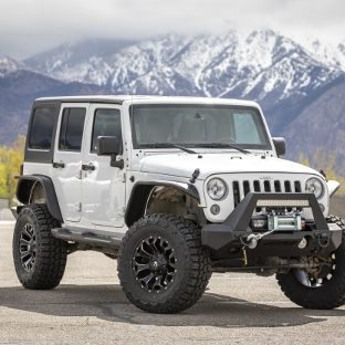 White 2016 Jeep Wrangler JK Unlimited with ARIES Jeep fender flares and Jeep accessories