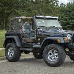 Jeep Wrangler TJ with ARIES Jeep doors, TrailCrusher™ bumper and LED lights