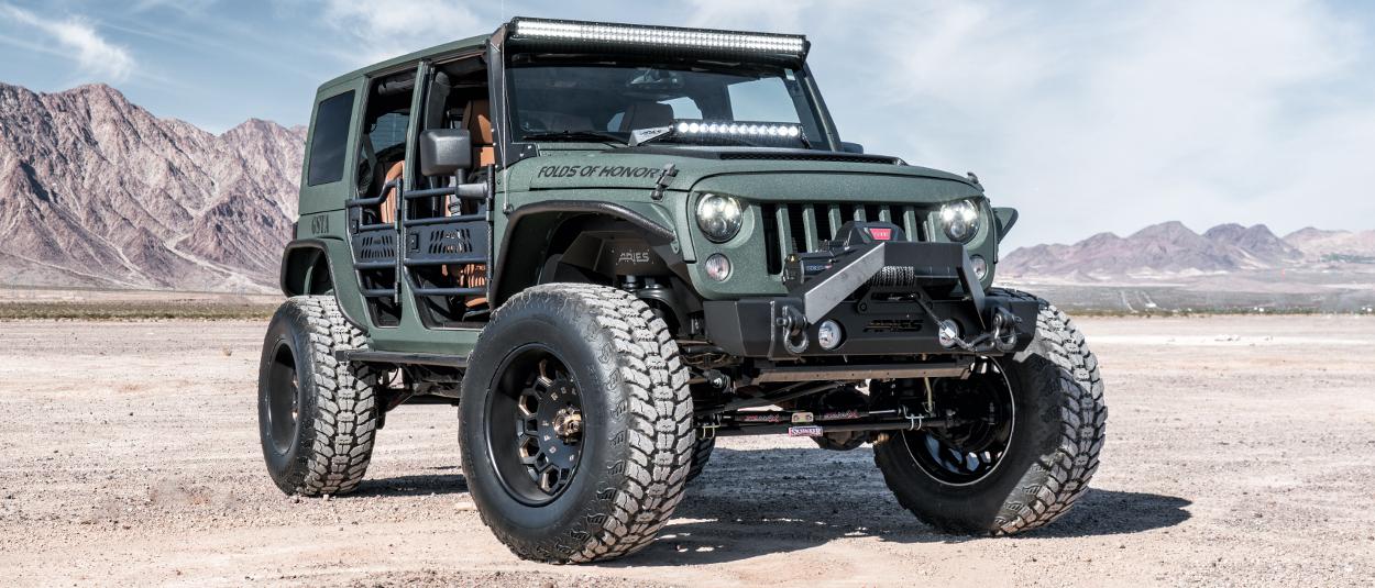 ARIES Jeep Wrangler accessories on custom tactical green Jeep Wrangler JK - desert