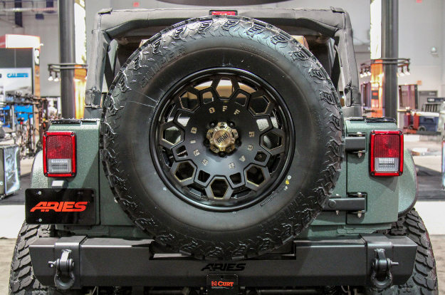 ARIES Jeep Wrangler tire carrier with offroad tire - rear spare