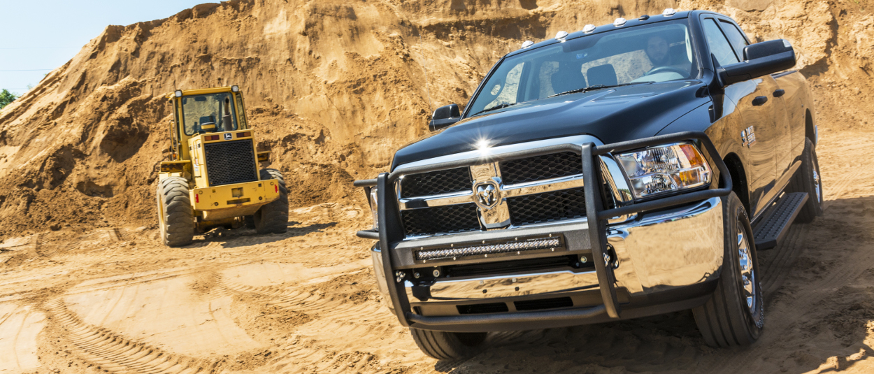 2015 Ram 3500 work truck with ARIES RidgeStep® running boards and truck accessories - construction site