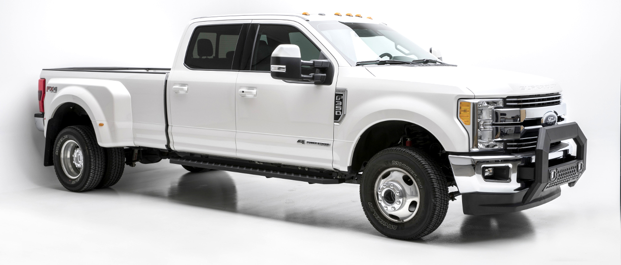 White 2017 Ford F350 Super Duty work truck with ARIES RidgeStep running boards