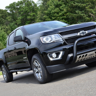Black 2016 Chevrolet Colorado with ARIES Rocker Steps and truck accessories