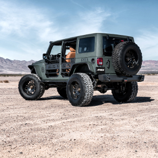 Tactical desert custom 2016 Jeep Wrangler JK with ARIES Rocker Steps and Jeep accessories