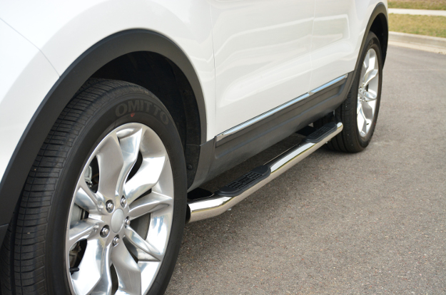 ARIES 3-inch round side bars on white SUV