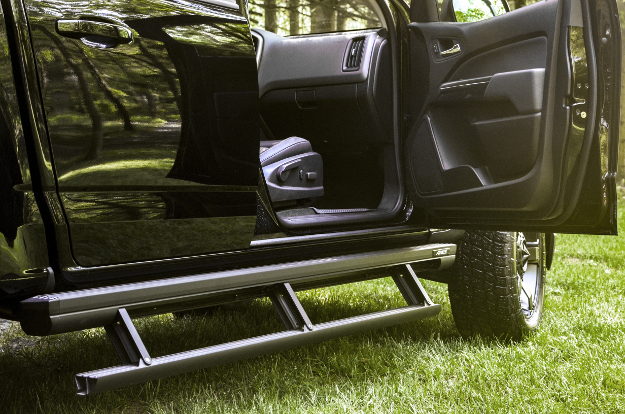 ARIES ActionTrac™ powered running boards on black truck