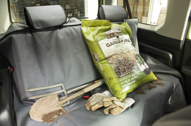ARIES Seat Defender™ bench seat cover with dirty tools